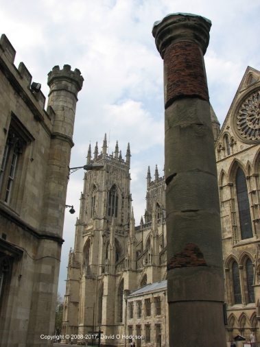 Roman Column in York, which was originally part of the Basilica. It was found under York Minster, in the background